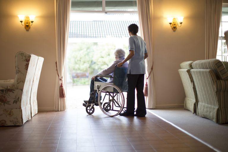 Nurse pushing patient in wheelchair