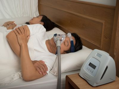 A man wearing his CPAP mask