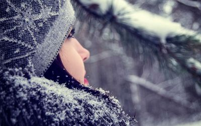 Close-Up Of Young Woman Looking Away During Winter