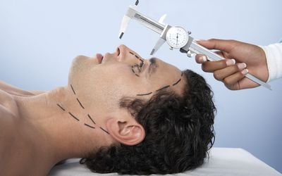 Man on surgery table preparing for a nose job
