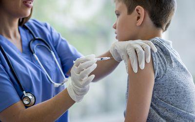 Boy getting flu shot