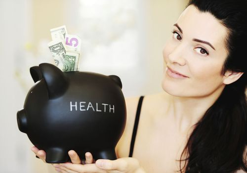 "Woman with a piggy bank labeled ""Health"""