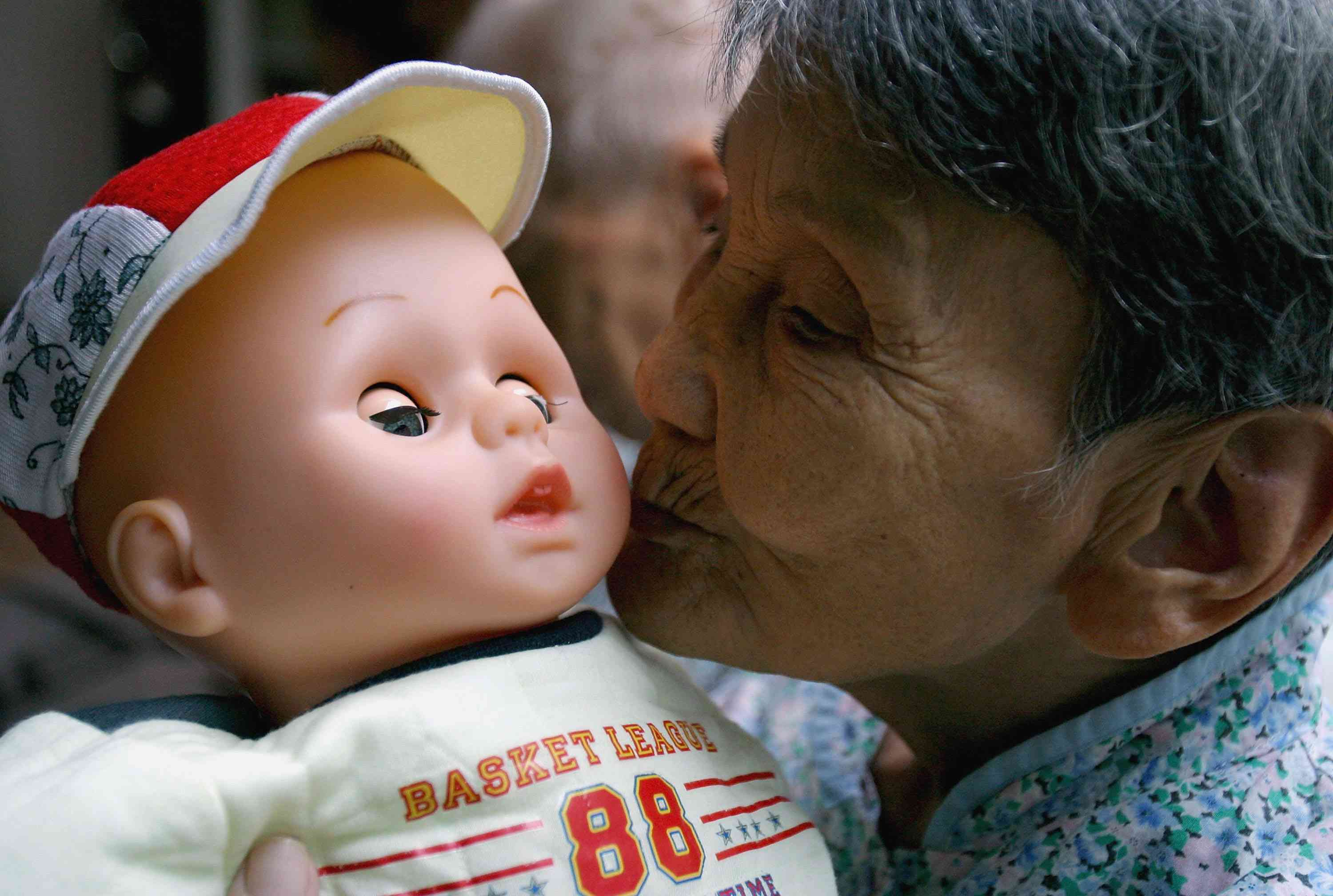 A woman with dementia and her baby doll
