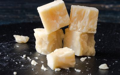 Close up of cheddar cheese on a table