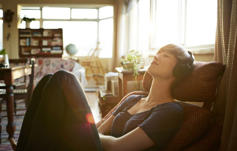 Young woman relaxing with headphones at home
