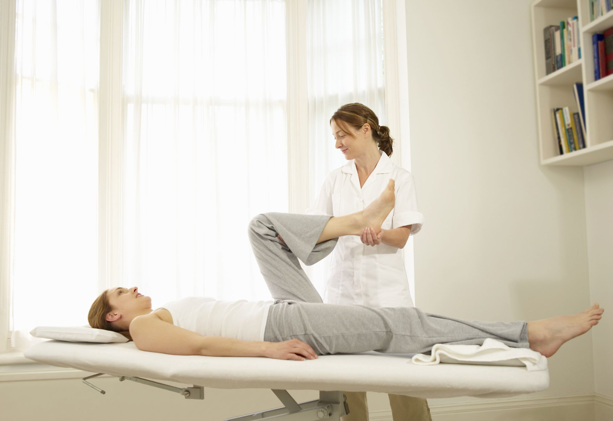 A physical therapist working with her patient