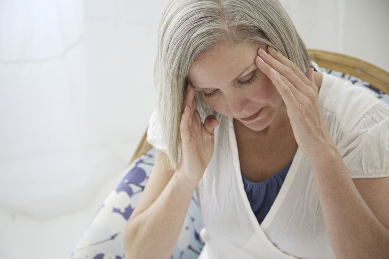 Middle aged woman with a headache