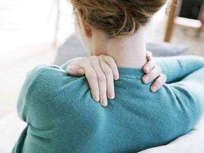 Woman rubbing her sore neck