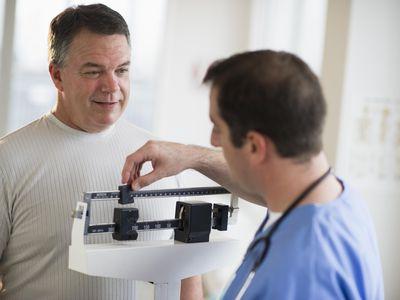 doctor weighing patient