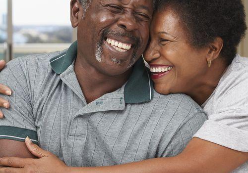 Senior man and woman laughing