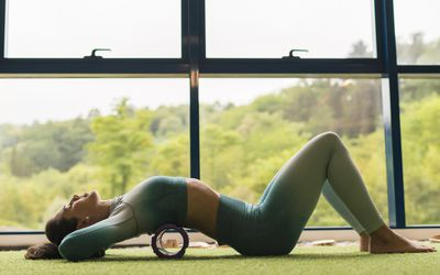 Woman exercising on a foam roller