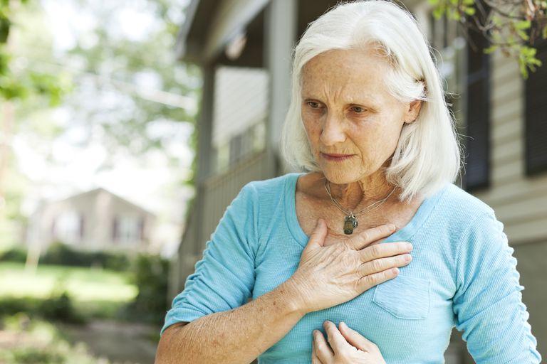A senior woman having heartburn.