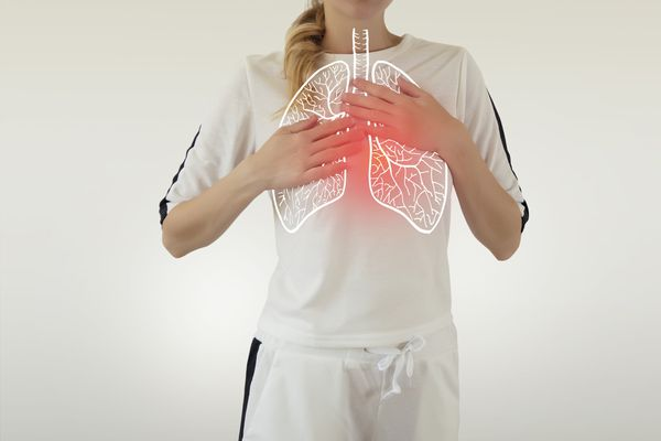 woman with recurrent respiratory infections touching her chest and wondering about causes