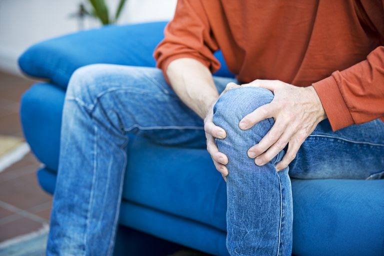 Man holding his knee in pain