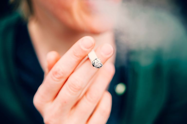 Close up of cigarette in woman's someone's hand
