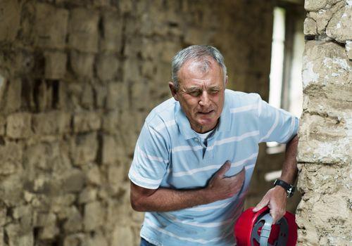 A man with chest pain needing an advil