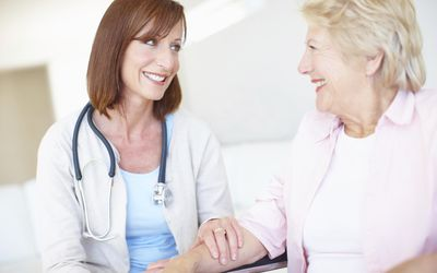 doctor laughing with her patient