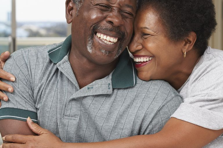 Senior man and woman laughing