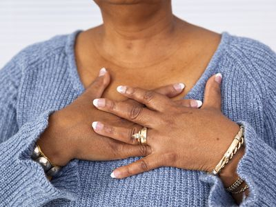 Woman with hands over her chest