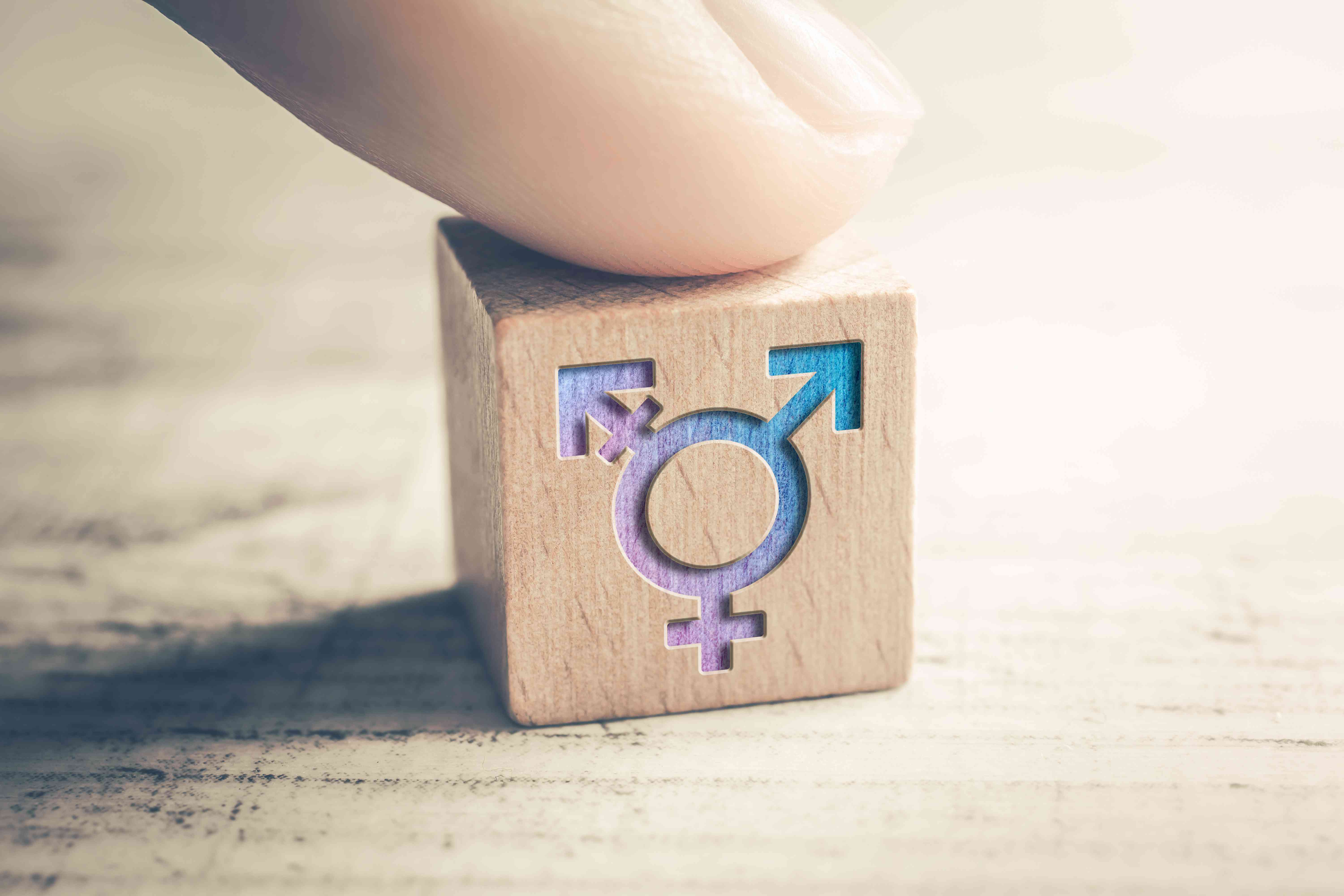 Transgender icon on a wooden block