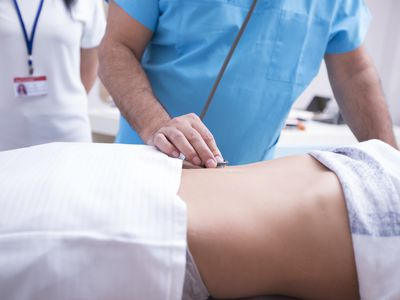 Stomach pain being evaluated by a doctor