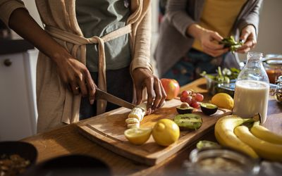 Two women cooking healthy food.