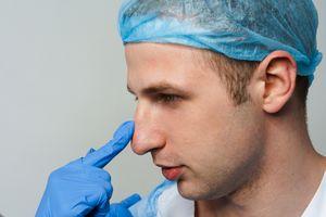 Examining nose before septoplasty surgery