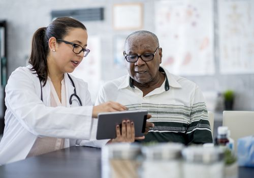 Doctor With A Tablet Computer - stock photo
