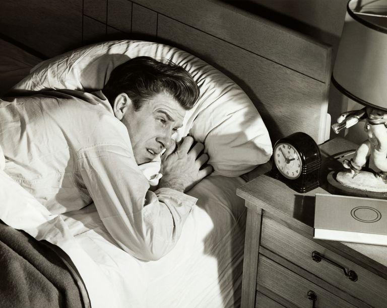 A man has difficulty sleeping