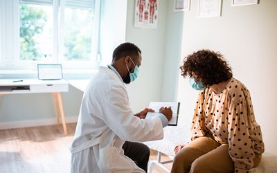 woman at doctor discussing uterine fibroids