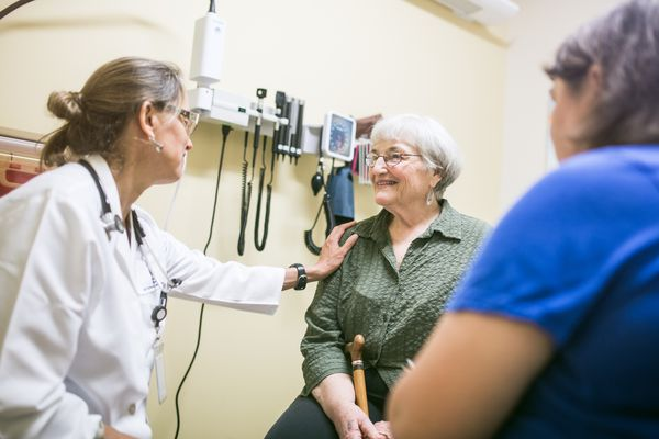 A doctor talking to her senior patient