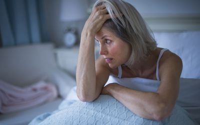 A senior woman dealing with insomnia.