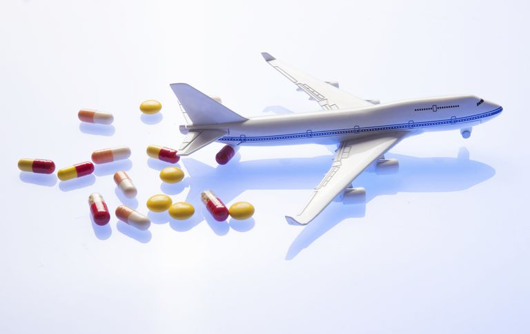 toy airplane next to pills