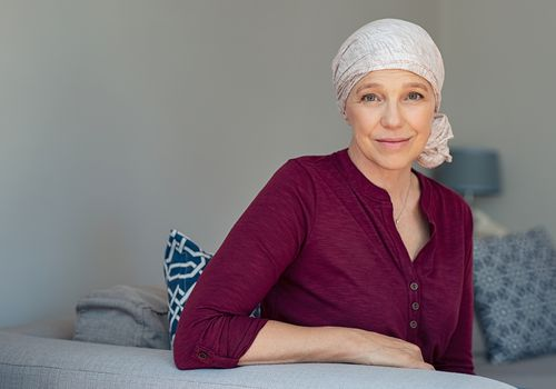 bald woman with cancer wondering if the disease will ever be cured