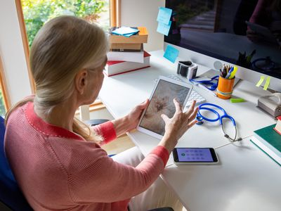 Telehealth doctor looks at photos of patient's rash