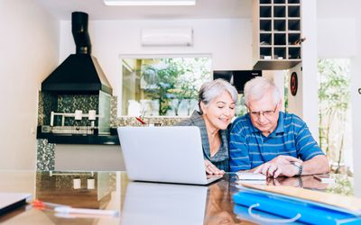 Senior couple reviewing finances