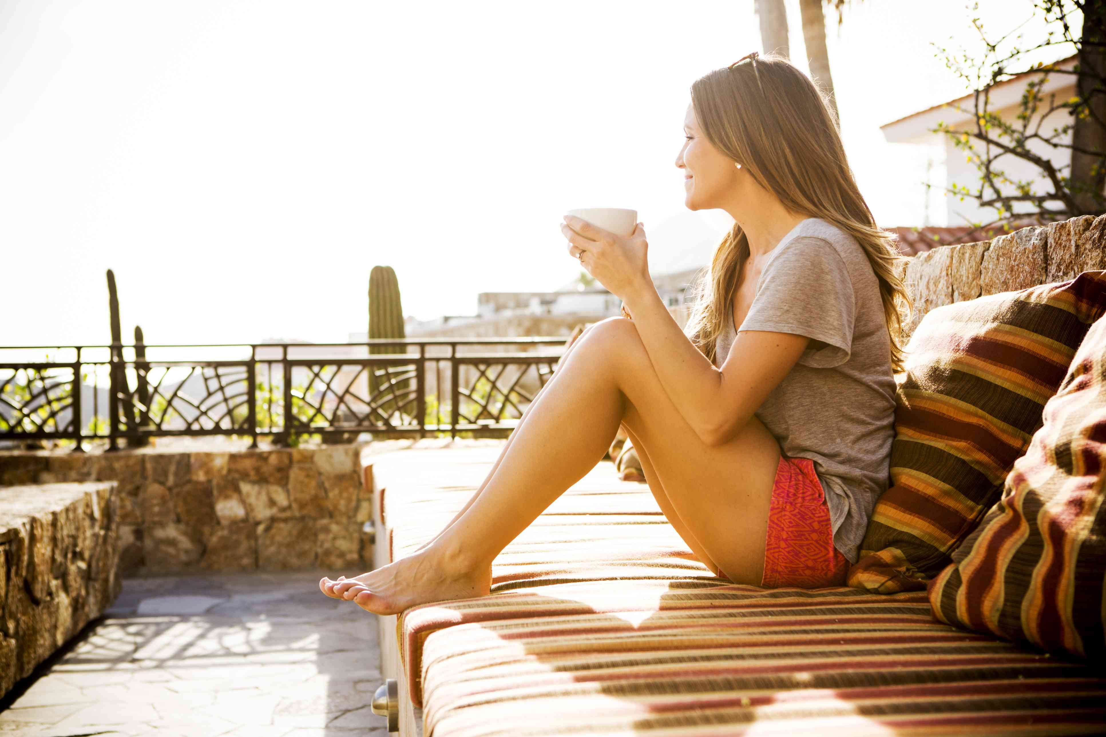 A woman sitting alone on an outdoor couch