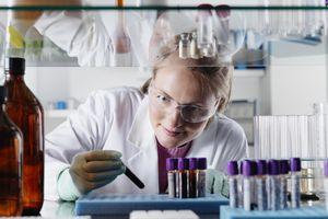 Scientist examining test tubes in lab