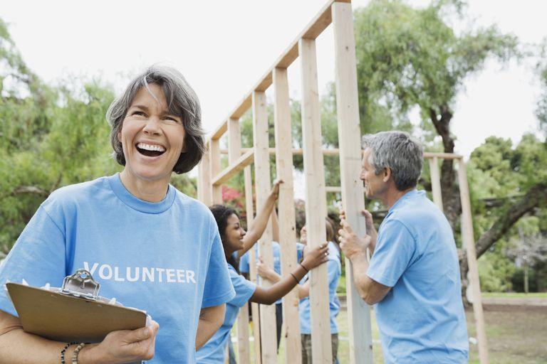 Volunteers building houses