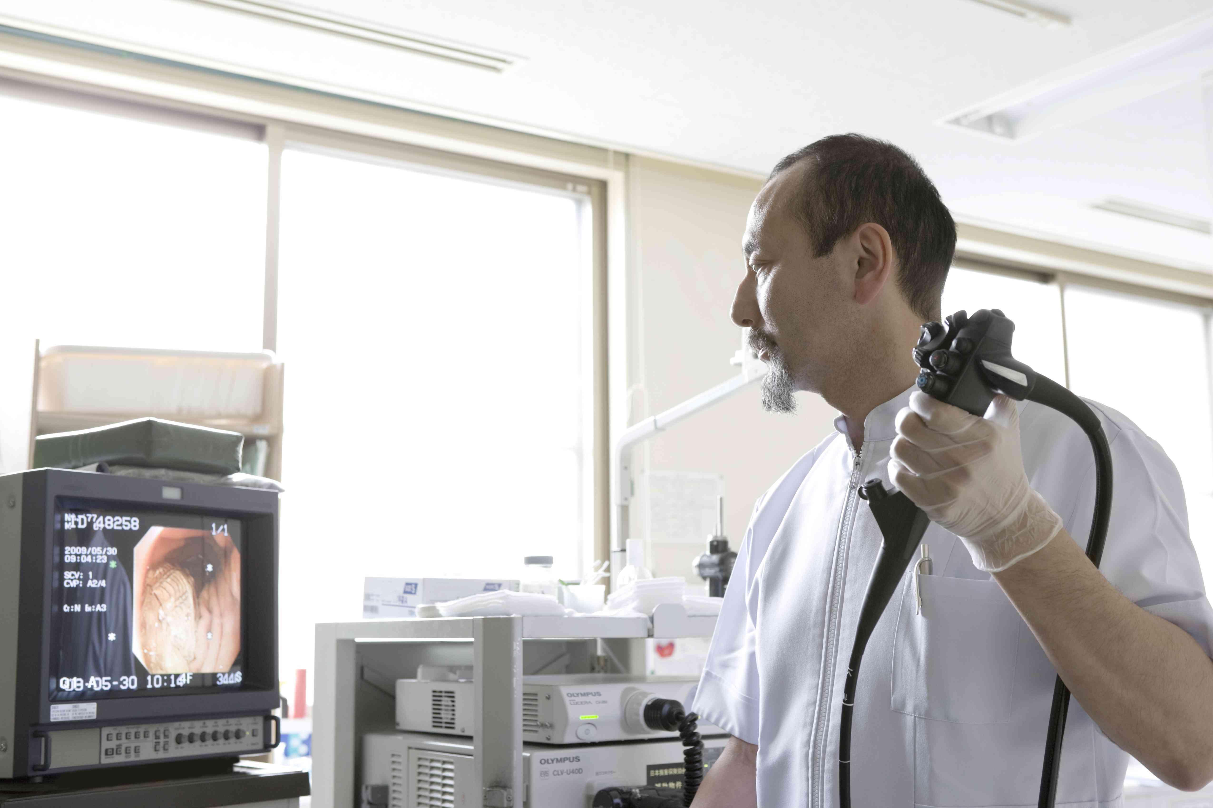 Doctor using endoscope