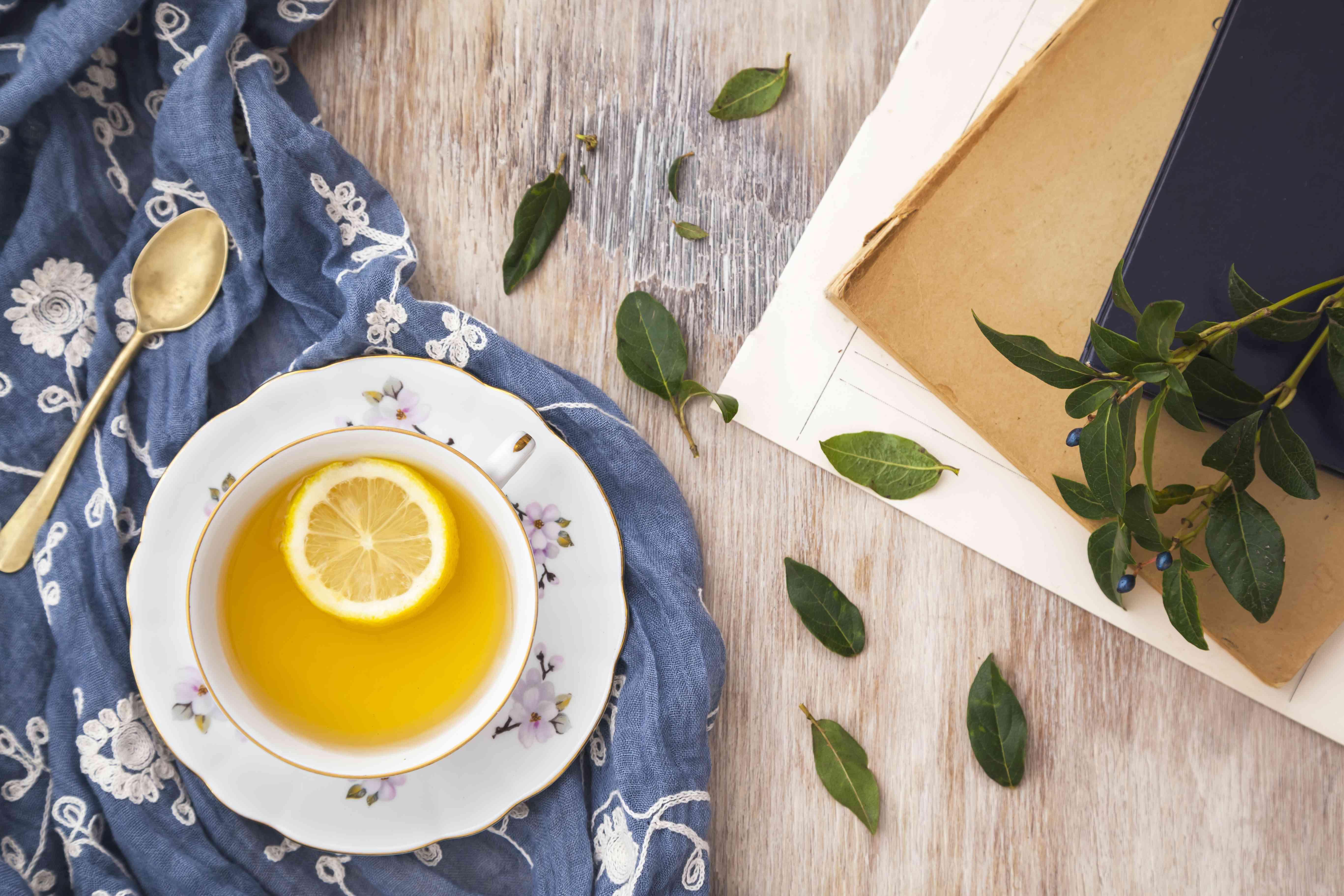 Cup of green tea with lemon slice