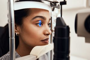 Young woman having a slit lamp exam.