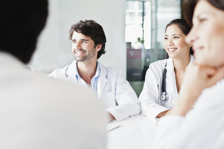 Doctors smiling in meeting