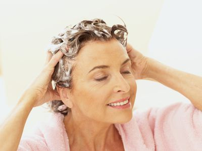older woman shampooing