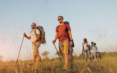 hikers walking in long grass