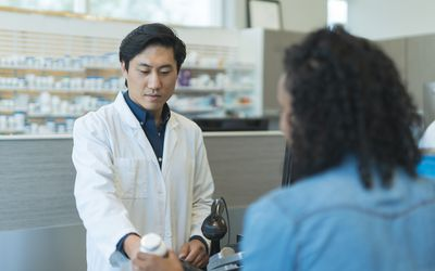 Pharmacist discusses medication with client