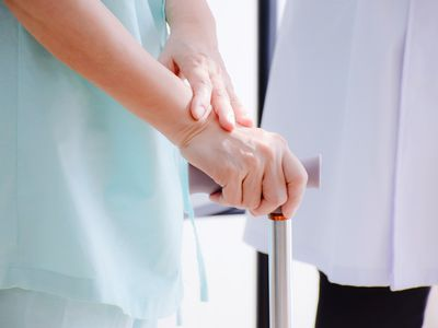 a woman leaning on a cane