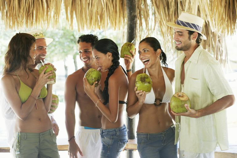 Group of friends sipping coconut with straw