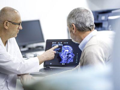 Doctor showing patient his brainscan