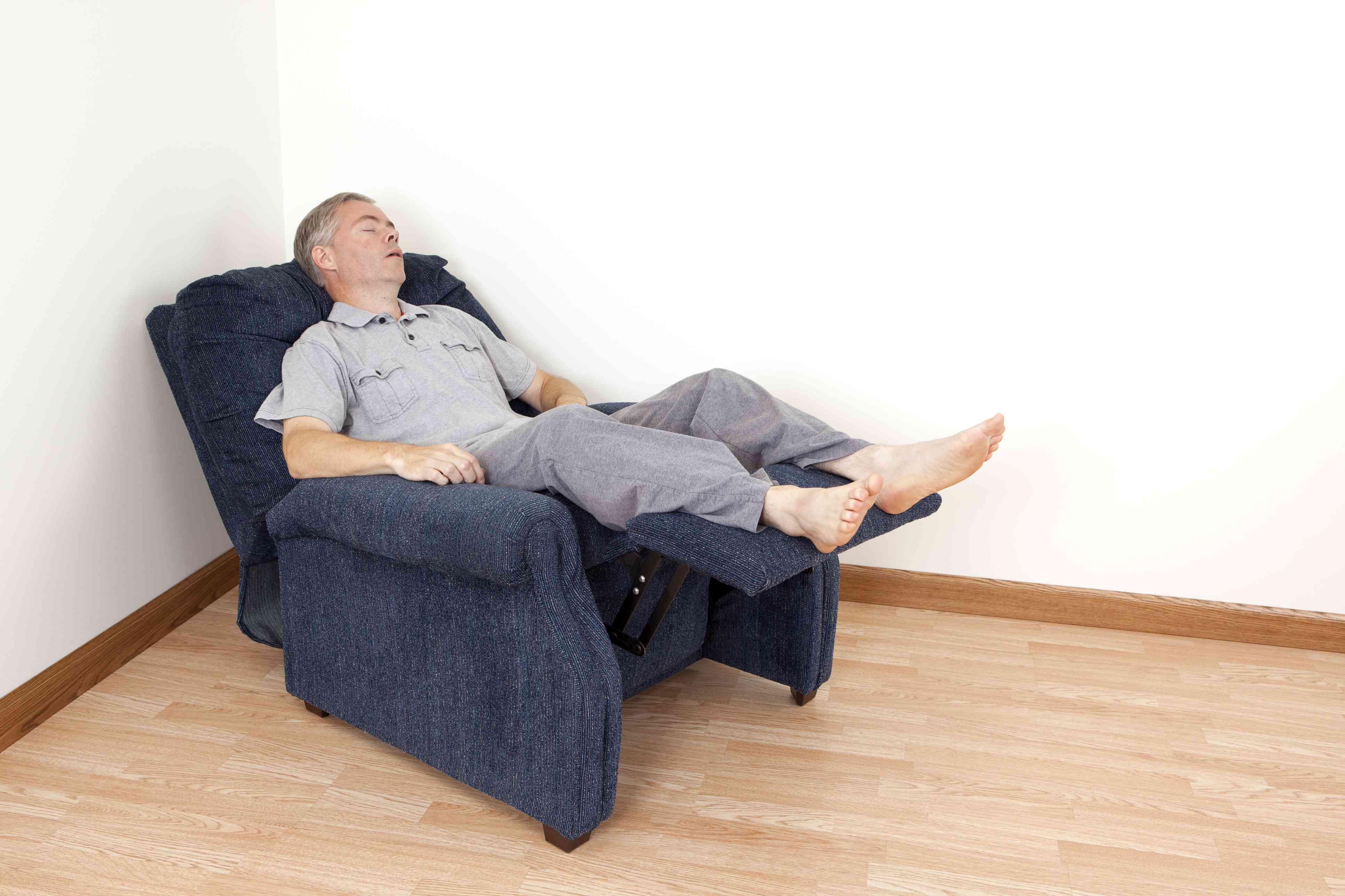 Man sleeping in a recliner chair